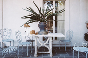Patio furniture arranged on a porch
