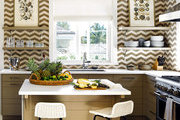 A beach house kitchen with walls covered in chevron tile