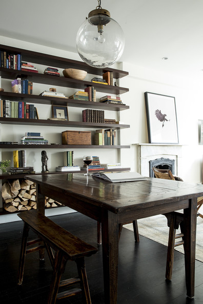 Contemporary Bookshelf - A farm table flanked by two communal benches