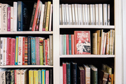 Books on white shelves in a retail environment