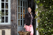 Artist Celine Chollet outside her French Cottage.
