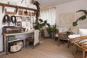 A neutral work and living space with white walls and a large jute rug.