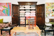 Pillows on display in a wooden armoire