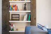 Built-in shelves filled with books and decorative objects
