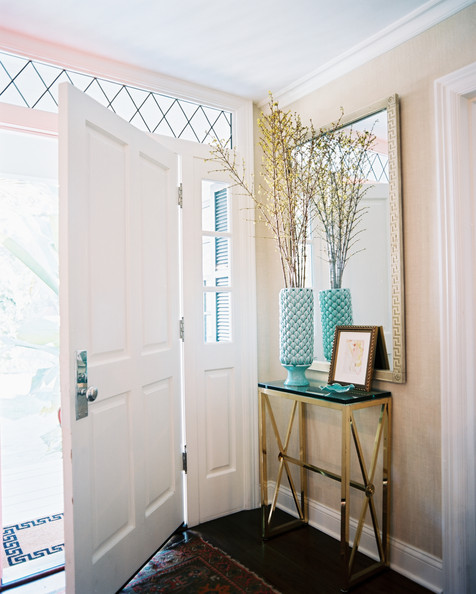 Entry - A brass table and a patterned rug in an entryway