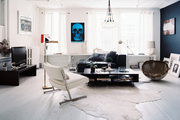 A masculine studio with a white hide rug