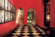Checkered floors paired with red walls and a series of framed photographs
