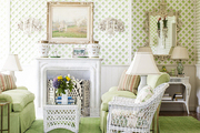 A green sitting room with white latticework wall covering