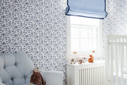 Patterned wall paper in children's bedroom.