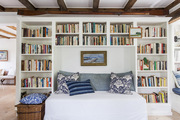 Custom bookshelves with a reading nook