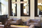 Deep armchairs and salvaged wood pieces at Napa Valley's Bardessono hotel