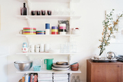Open shelves with dining essentials and a midcentury sideboard