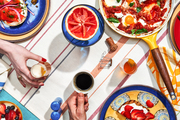 A couple enjoys a colorful brunch spread