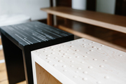 A detail of wooden benches at a dining table.