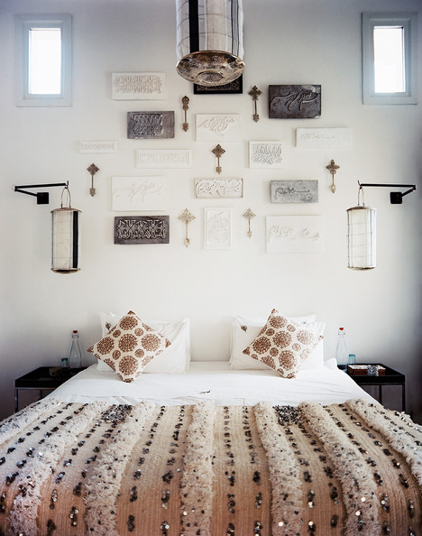 Gallery Wall - A bed dressed with a Moroccan wedding blanket
