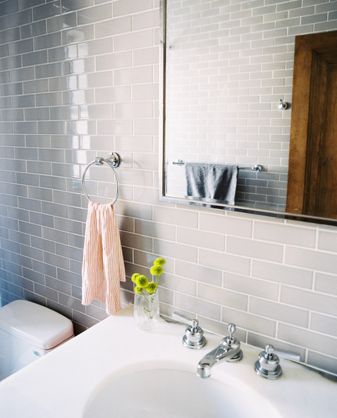 Gray bathroom gray subway tile and a striped hand towel in a