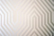 A silver patterned wallpaper