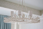 A white eclectic chandelier hangs in the bedroom of Emily Beare's apartment.