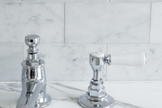 Chrome fixtures on a marble vanity