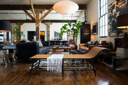 A pendant lamp, chaise longue, and assorted vintage pieces at Hammer and Spear's downtown LA loft