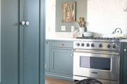 This farmhouse kitchen is painted in Yorktowne Green by Benjamin Moore.