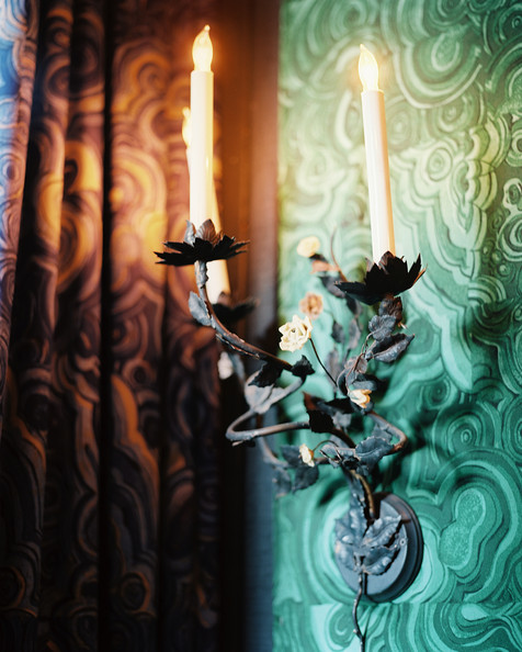 Hutton Wilkinson - A sconce backed by malachite wallpaper