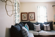 A corner bench topped with blue patterned pillows