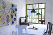 An art-filled dining porch