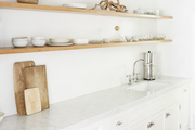 A white kitchen with wooden accents.