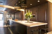 An expansive kitchen island surrounded by modern barstools