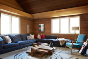 Blue and brown wood-lined living room