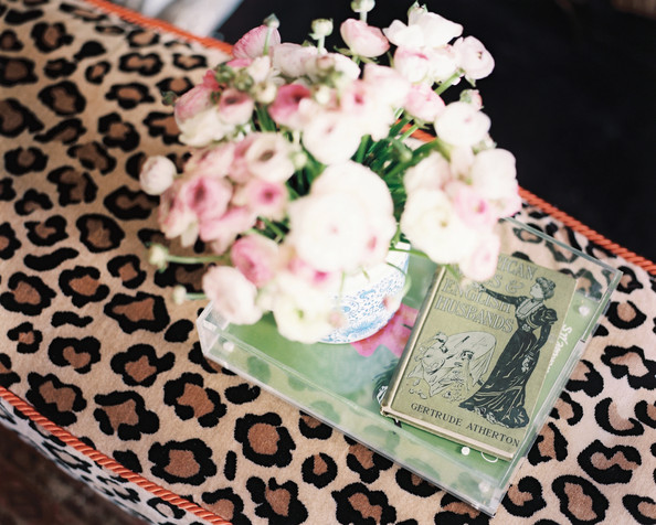 January February 2013 Issue - A tray with a book and flowers atop a leopard-print ottoman
