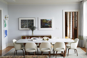 Modern table and chairs atop area rug in contemporary dining room.