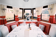 Red, white, and gray tones in a dining space aboard a yacht