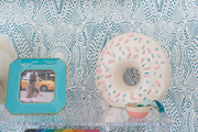 A detail of a white donut decor object.
