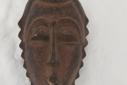 An African mask on a white surface