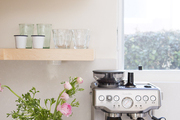 floating wood shelves in a white kitchen