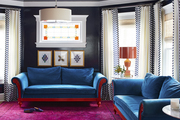 Navy lacquered wallpaper sheathes a colorful family room designed by BHDM.