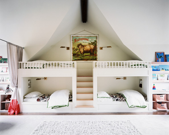 Kids' Room - Bunk beds and shelving for books in a children's bedroom