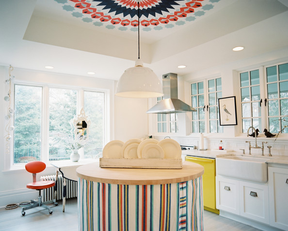 Kitchen - A round island with a colorful striped skirt