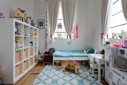 A colorful kids room with tons of toys.