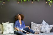 Textile designer Bridgid Coulter lounges among Ikat-style pillows