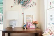 A wooden desk topped with kid-friendly accesories