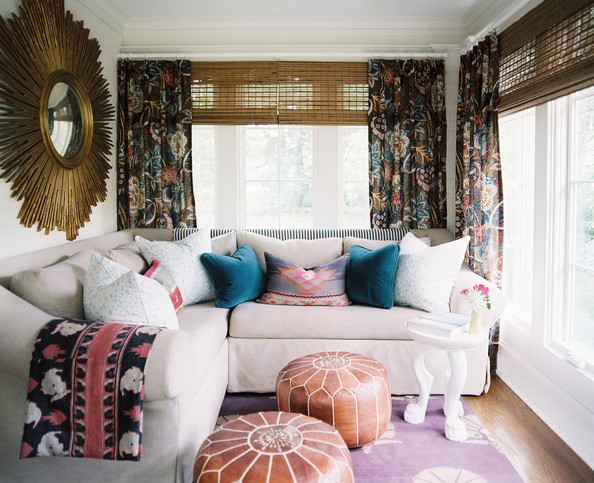 Living Room Curtains - A tan sectional and a gold starburst mirror in a sunporch