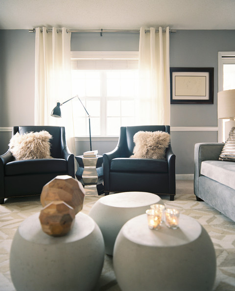 Living Room - A pair of black leather armchairs in front of white curtains