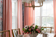 In the dining room, Lee Jofa wallpaper lightens the mood around the Caracole farm table.