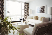Geometric curtains with a white sofa and chairs