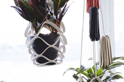 Leather, tassel-embellished hanging planters by Cold Picnic