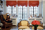 Antonia Thompson seated in a leather wingback chair in her Greenwich Village apartment