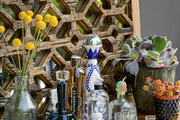A colorful bar with hobnail glasses and succulents